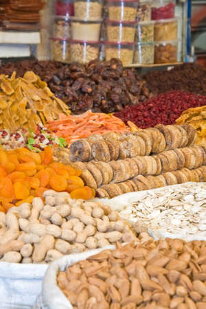 Colorful healthy dried fruits and nuts in the market, focus on figs photo