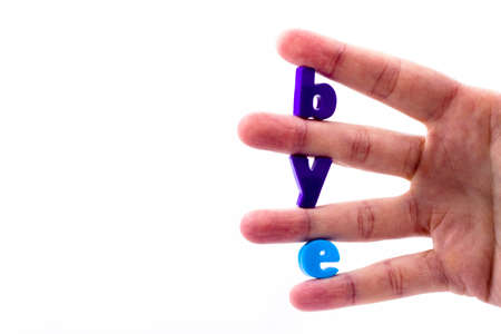 The letters in blue held between the fingers folded inscription bye photo