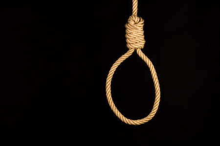 execution loop of strong natural draft rope on a black background photo