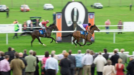 spectators: Winner finishing the race Stock Photo