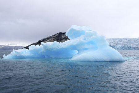 arctic waters: Iceberg in Arctic waters (Napassorsuaq Fjord, Greenland) Stock Photo