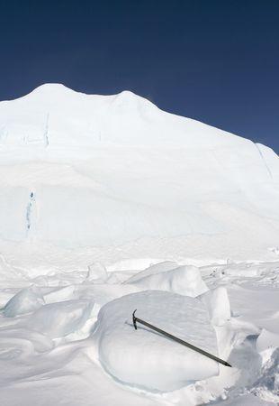 ice axe: Ice axe stuck in an iceberg Stock Photo