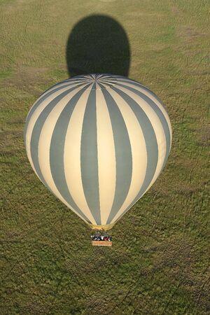 Hot air balloon flying over Serengeti National Park, Tanzania photo