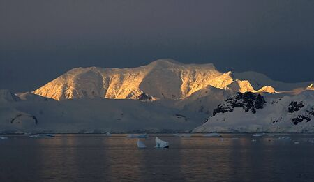 scot: View of the mountains at dusk in Paradise Bay, Antarctica