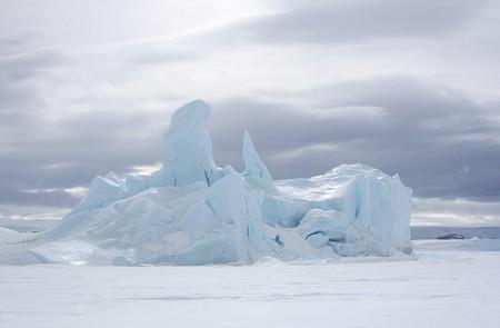 frozen solid: Iceberg frozen solid in the sea ice of Antarctica Stock Photo