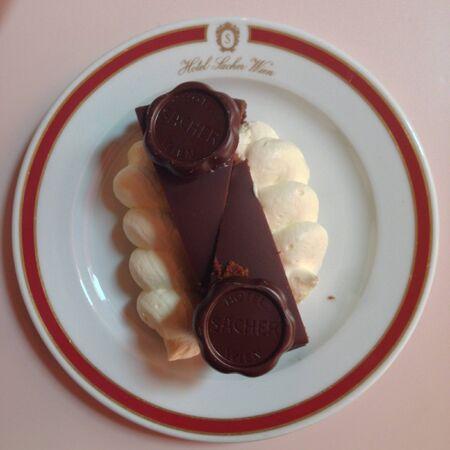 torte: Wiener Sacher torte on a plate of the original Sacher Hotel