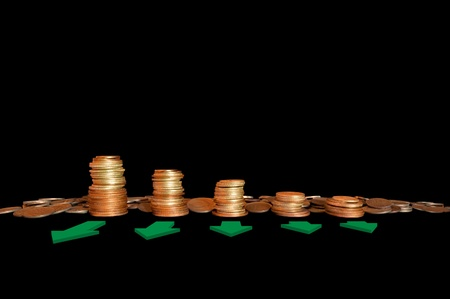 Coins in stacks with arrows Stock Photo