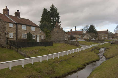 The opening view of Hutton-Le-Hole as you enter the village from the south. The attractive beck runs through the centre of the village green.