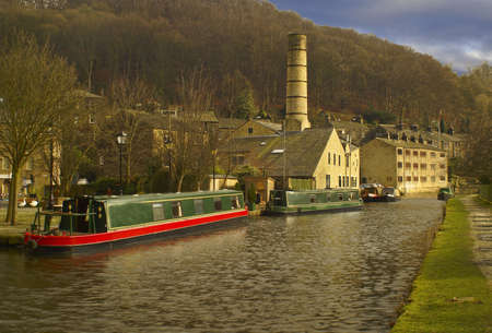 Canal barges on the Rochdale Canal, in the town center of Hebden Bridge, Yorkshire  England