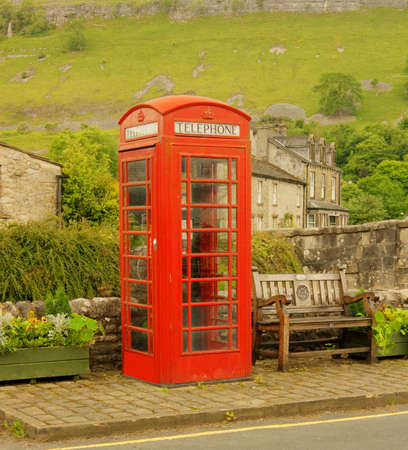 An old style red phone booth in the attractive village of Kettlewell, North Yorkshire  photo