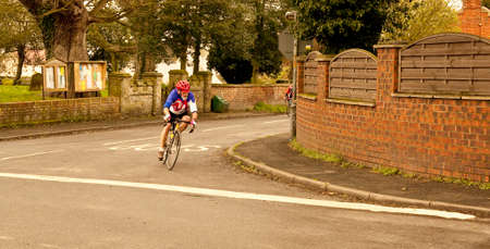 catch up: A lone cyclist struggles to catch up with the leaders in this time trial event  staged in Lincolnshire  Editorial