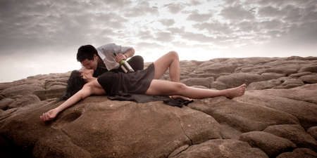 sexy couple kissing: Young beautiful sexy couple in love flirting at the beach