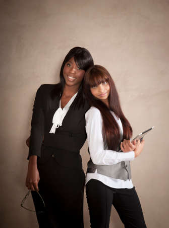 Two attractive business woman of mixed race working together photo