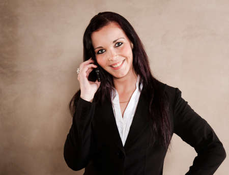 Young attractive business woman having a conversation on smartphone photo