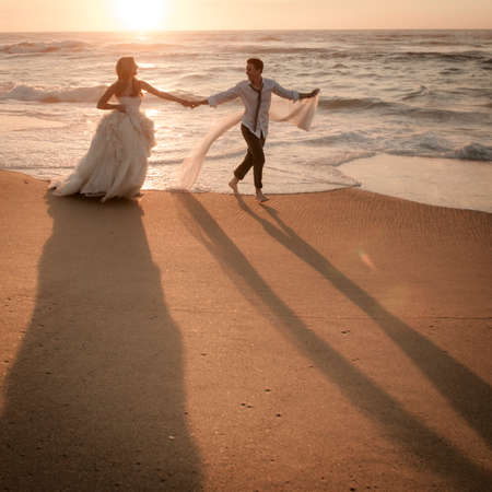 sexy couple on beach: Young beautiful bridal couple having fun together at the beach Stock Photo
