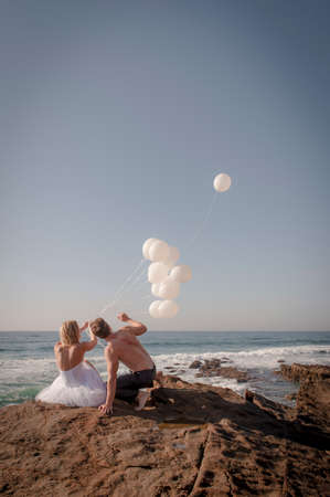 newly weds: Young beautiful bridal couple having fun together at the beach Stock Photo