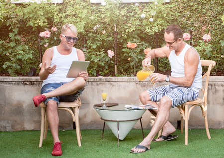 mid thirties: Handsome Gay couple enjoying some time together outdoors