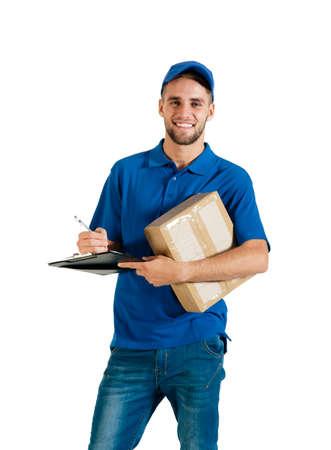 Junger stattlicher Kurier, der eine Anlieferung Standard-Bild - 37246267