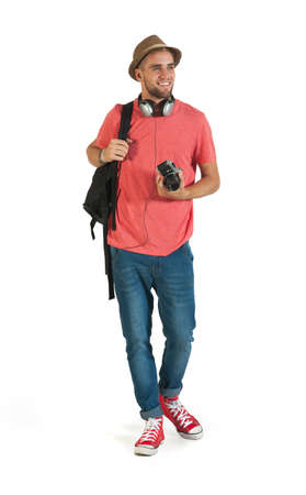 Young happy tourist traveling with camera and pack