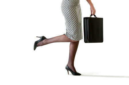 attache: Close up of business woman in pencil skirt holding attache case in high heels Stock Photo