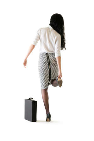 pencil skirt: Young business woman adjusting her high heel shoe
