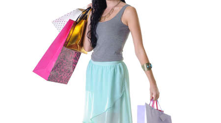 purchased: Close up of young beautiful woman carrying all her purchased parcels