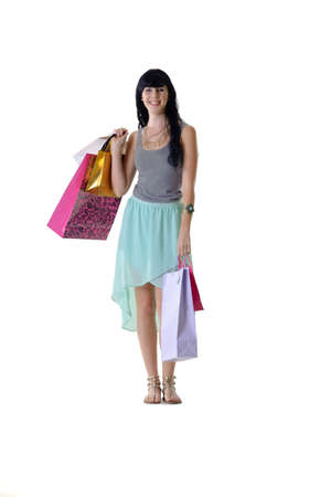 snazzy: Young beautiful woman wearing fresh colours carrying all her purchased parcels