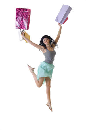purchased: Young beautiful woman jumping with all her purchased parcels