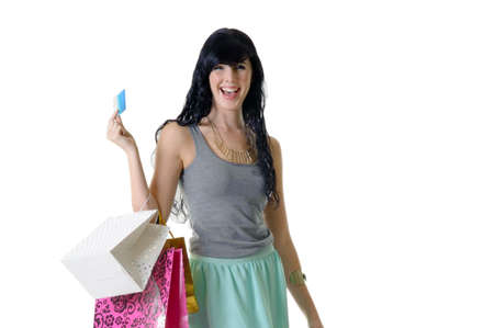 purchased: Young beautiful woman showing off her bank card and new purchased parcels