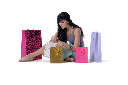 snazzy: Young beautiful woman looking through all her purchased parcels Stock Photo
