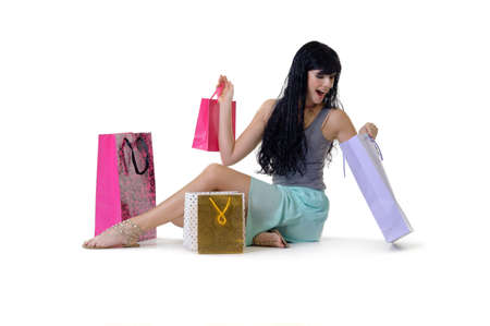 purchased: Young beautiful woman looking through all her purchased parcels Stock Photo