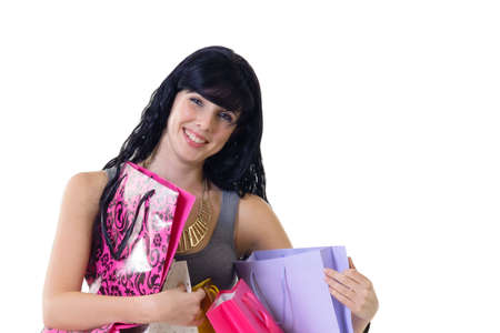 purchased: Young beautiful woman wearing fresh colours carrying all her purchased parcels