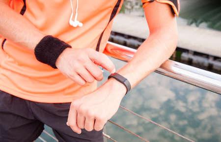 Close up of guy using wearable fitness gear Standard-Bild