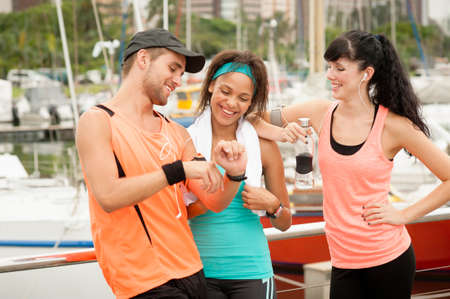 armband: Group of young happy runners exercising early in the morning together Stock Photo