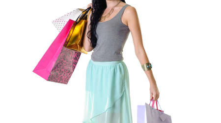 snazzy: Young happy shopper girl holding her purchase parcels Stock Photo