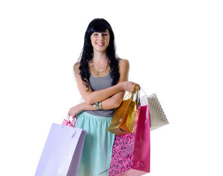 happy shopper: Young happy shopper girl holding her purchase parcels Stock Photo