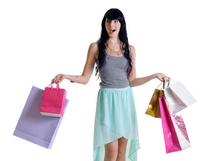 shopper: Young happy shopper girl holding her purchase parcels Stock Photo
