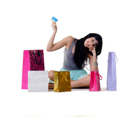 Young happy shopper girl holding her purchase parcels Stock fotó