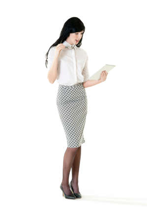 Young attractive business woman working with digital tablet