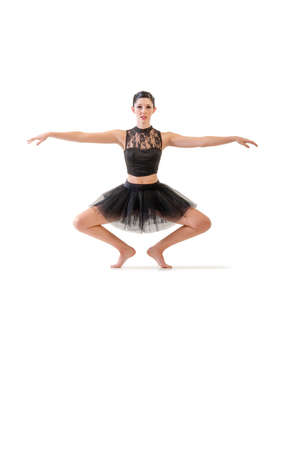 alternate: Young attractive ballerina performing alternate dance moves isolated on white background