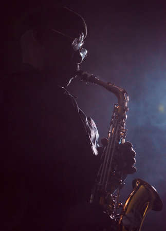african sax: African jazz musician playing the saxophone Stock Photo