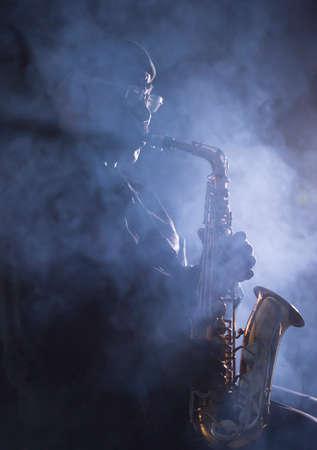 African jazz musician playing the saxophone Фото со стока