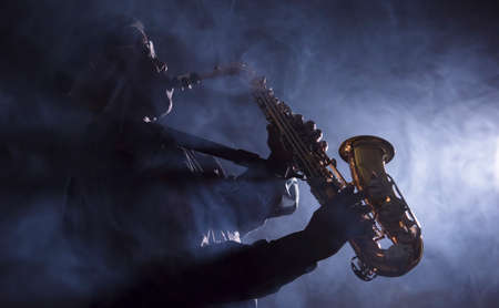 African jazz musician playing the saxophone Фото со стока