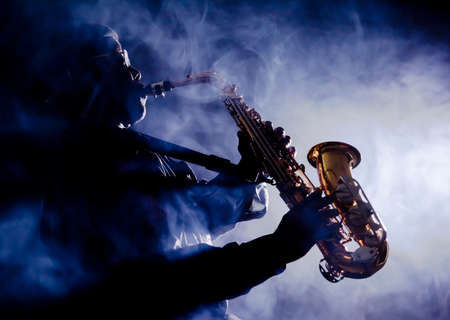 musician silhouette: African jazz musician playing the saxophone Stock Photo