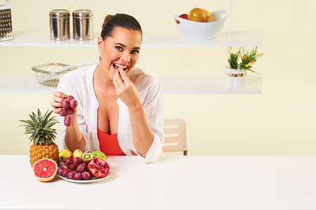 revitalizing: fruit grape eating snack health healthy diet,weight loss grapefruit Stock Photo