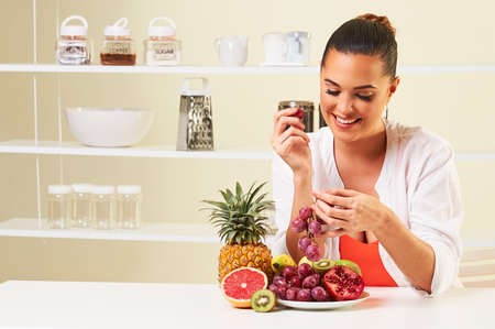 tantalizing: fruit grape eating snack health healthy diet,weight loss grapefruit Stock Photo