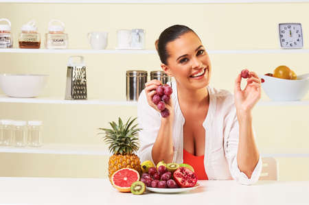 Woman eating various fruit  eating healthy on a diet.