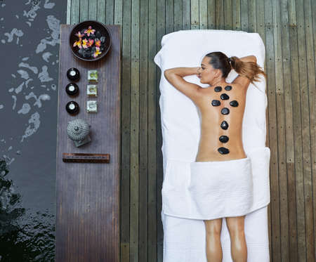 spirituality therapy: asian back massage therapy spa hot stone Stock Photo