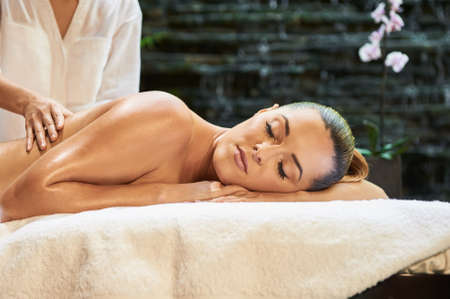 pondering: asian back massage therapy spa hot stone Stock Photo