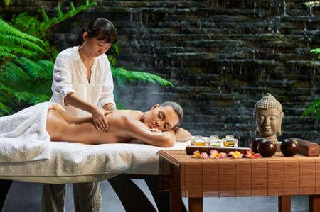 hot stone: asian back massage therapy spa hot stone Stock Photo